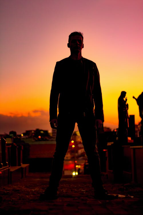 Standing Man Wearing Jacket and Pants during Sunset
