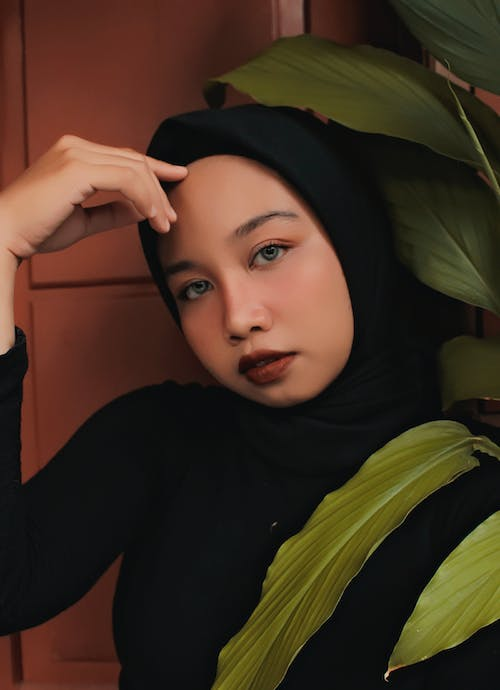 Close-up Photo of Beautiful Woman in Black Hijab Posing