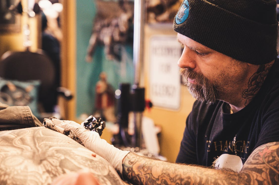 Man Tattooing Person