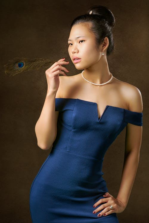 Woman In Blue Off-shoulder Dress