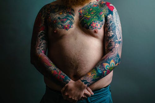 Multi-colored Floral Sleeve Tattoo Covering Man's Arms And Chest