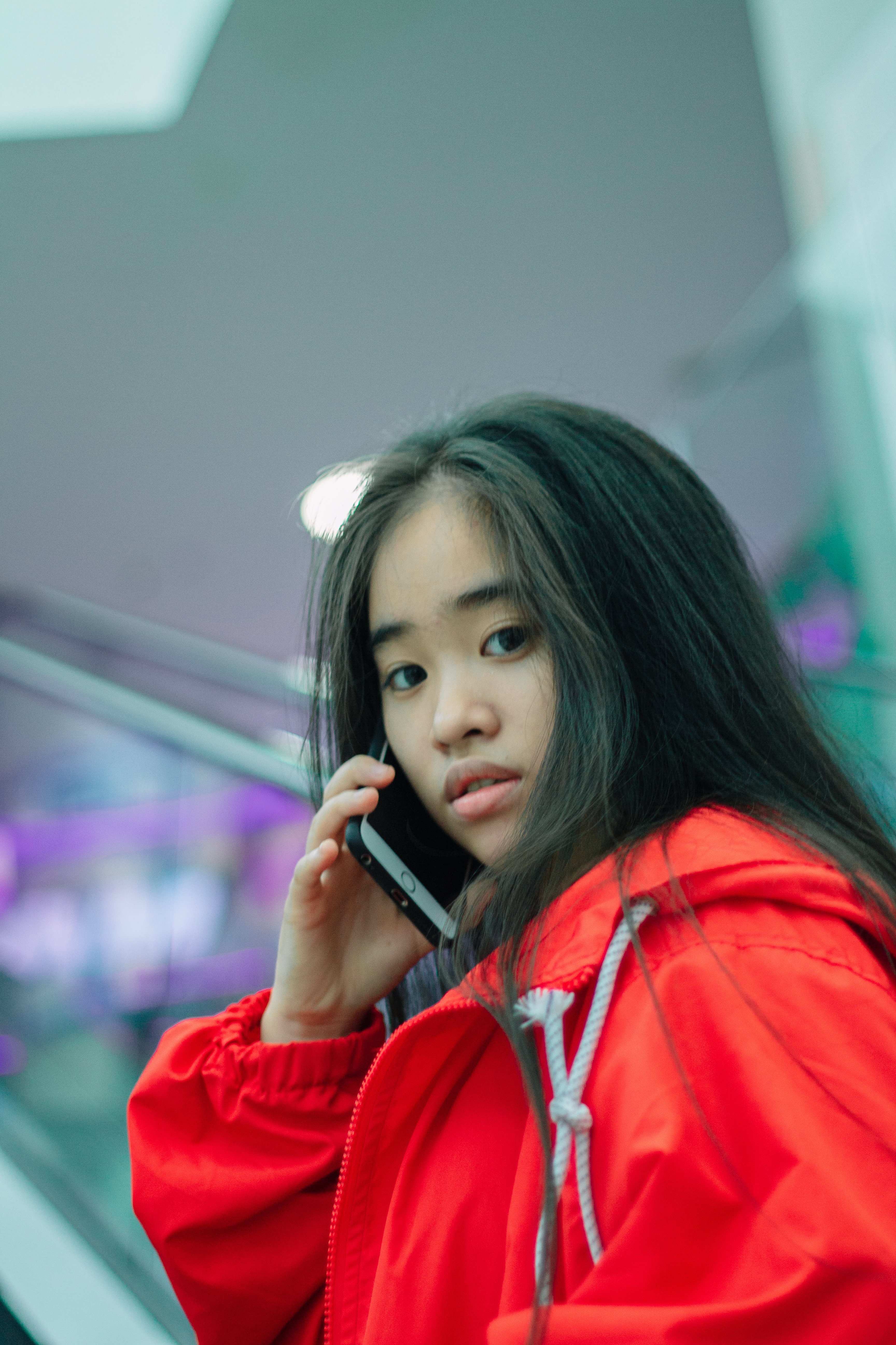Close-up Photo of Girl In Red Jacket Talking on Cell Phone