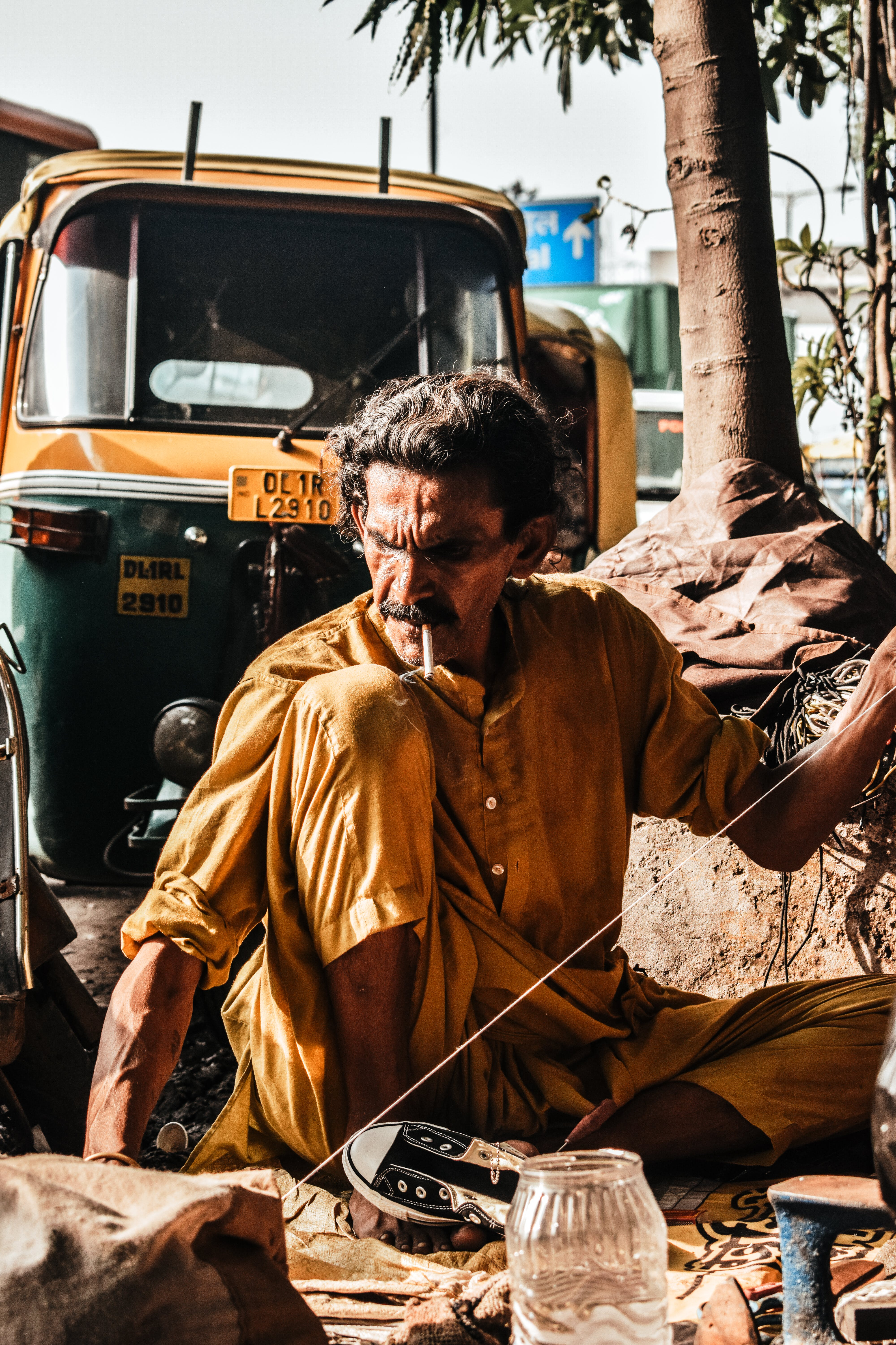 Man Sitting Near Autorickshaw