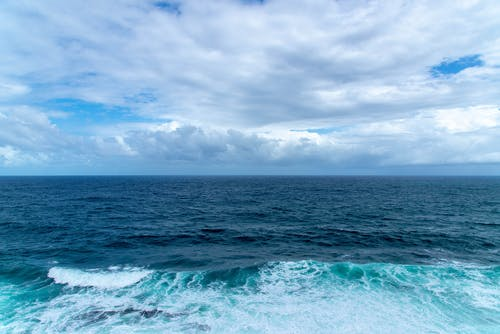 Photos gratuites de ciel, eaux bleues, écume, écume de mer