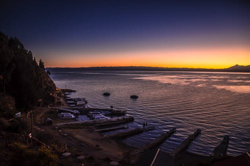 Fotos de stock gratuitas de amanecer, anochecer, lagos, mar