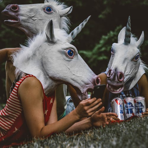Three Persons Wearing Unicorn Costumes