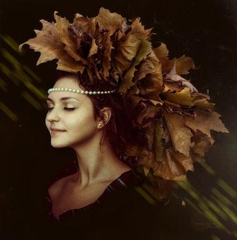 Woman Wearing Leaf Maked Hat