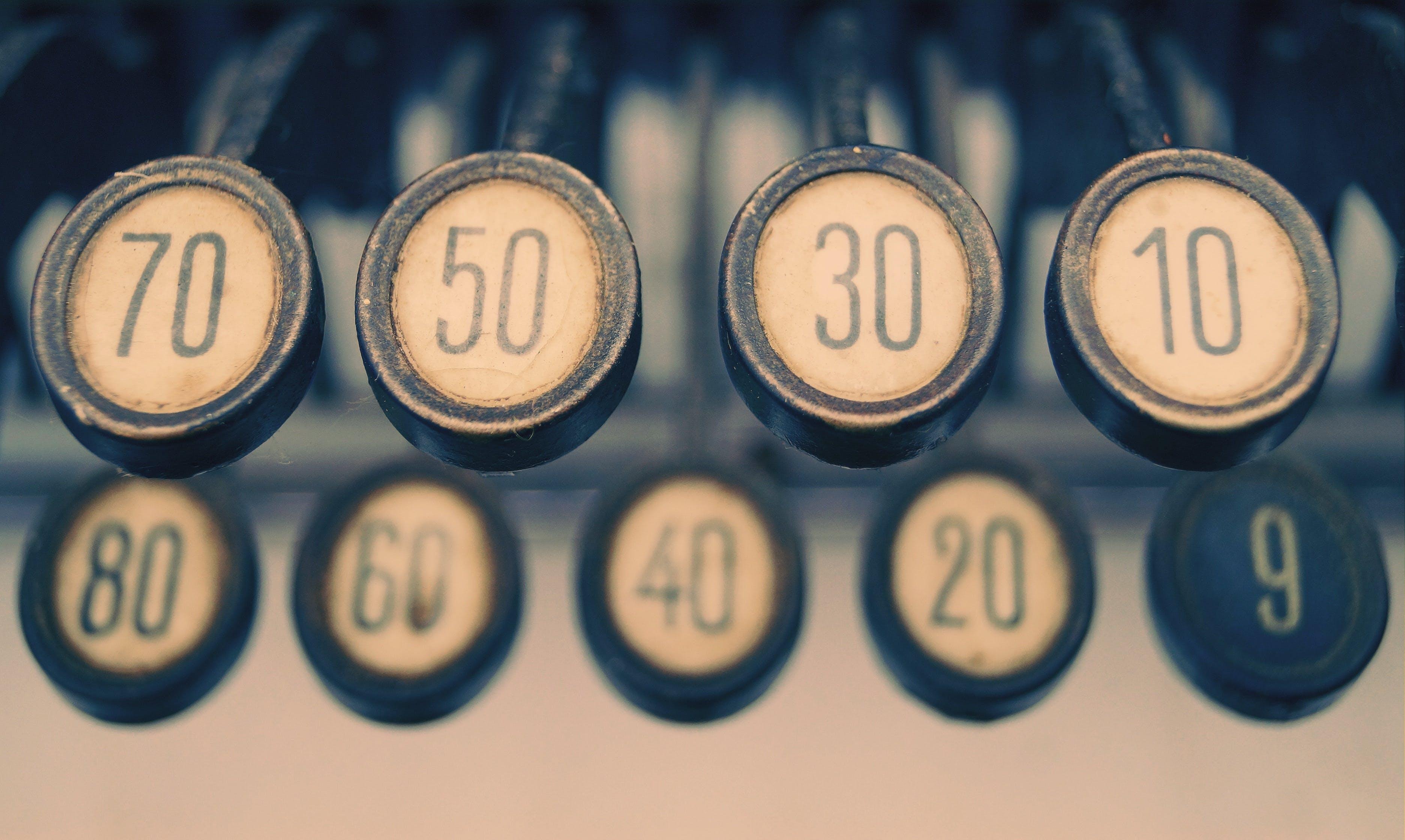Close-up Photography of Gray Adding Machine