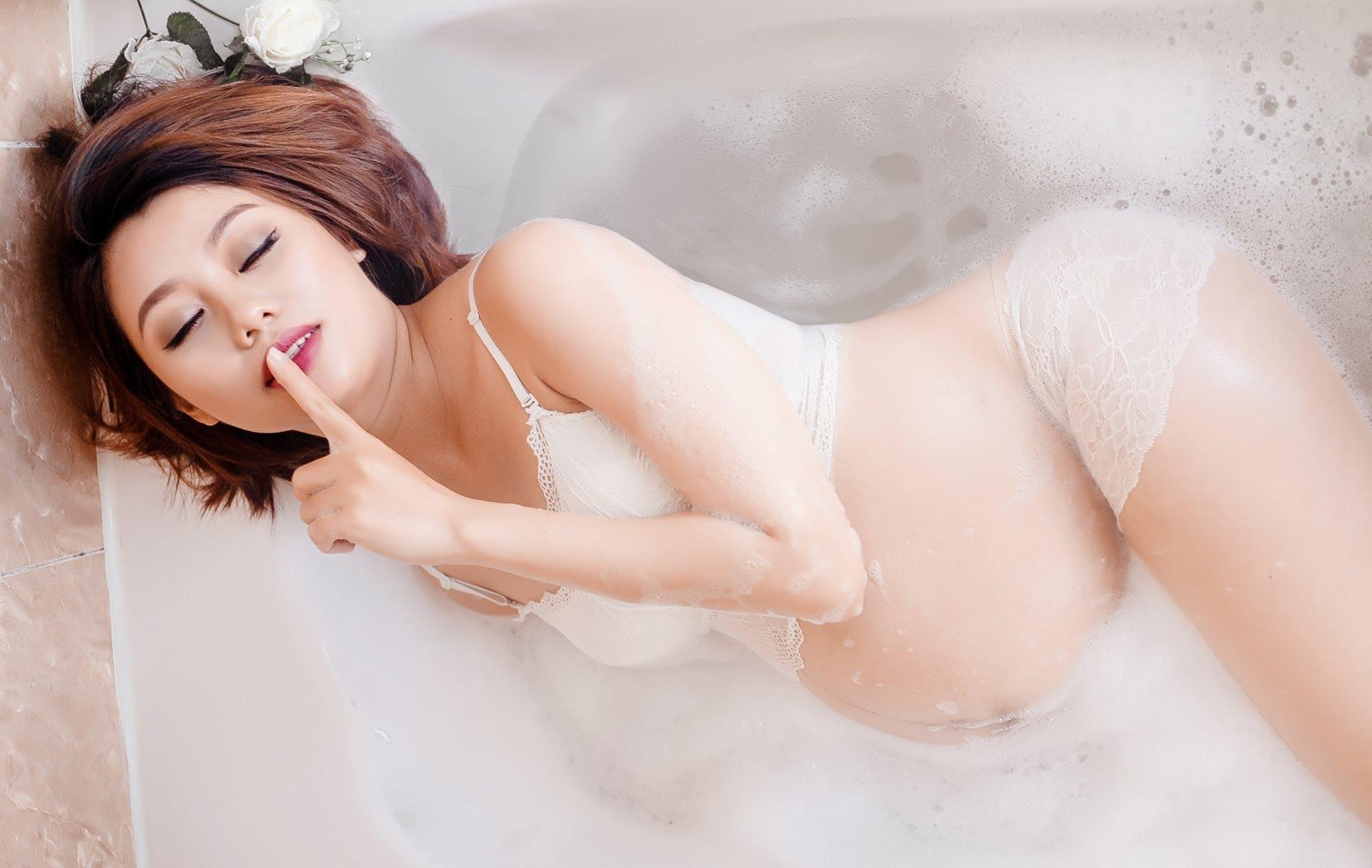 Pregnant Woman Lying on Bathtub