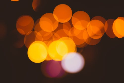 Abstract bokeh background with yellow and red lights