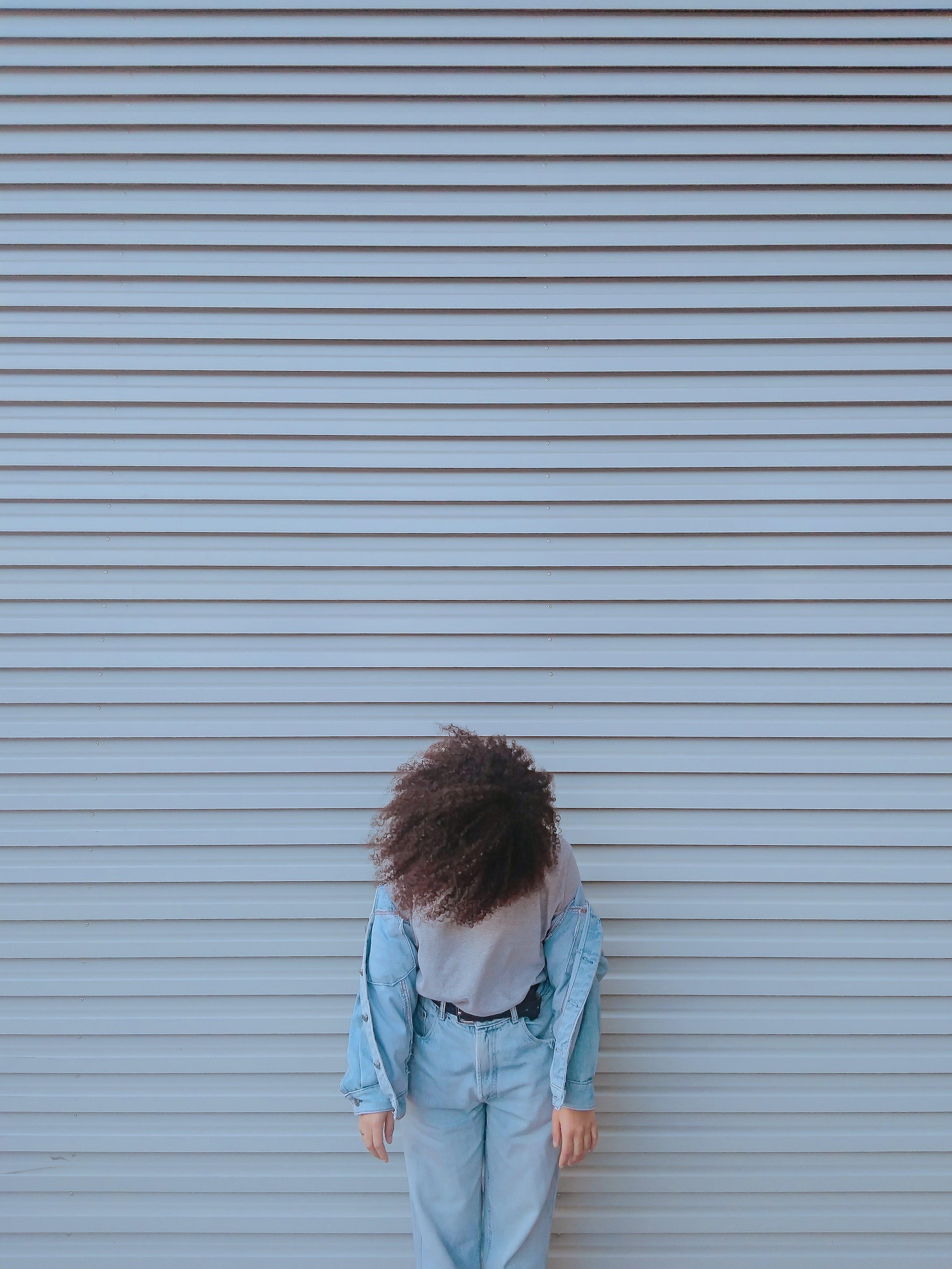 Woman Standing by Closed Shutter Door