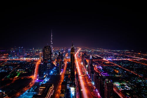 High Rise Buildings during Night Time Photo