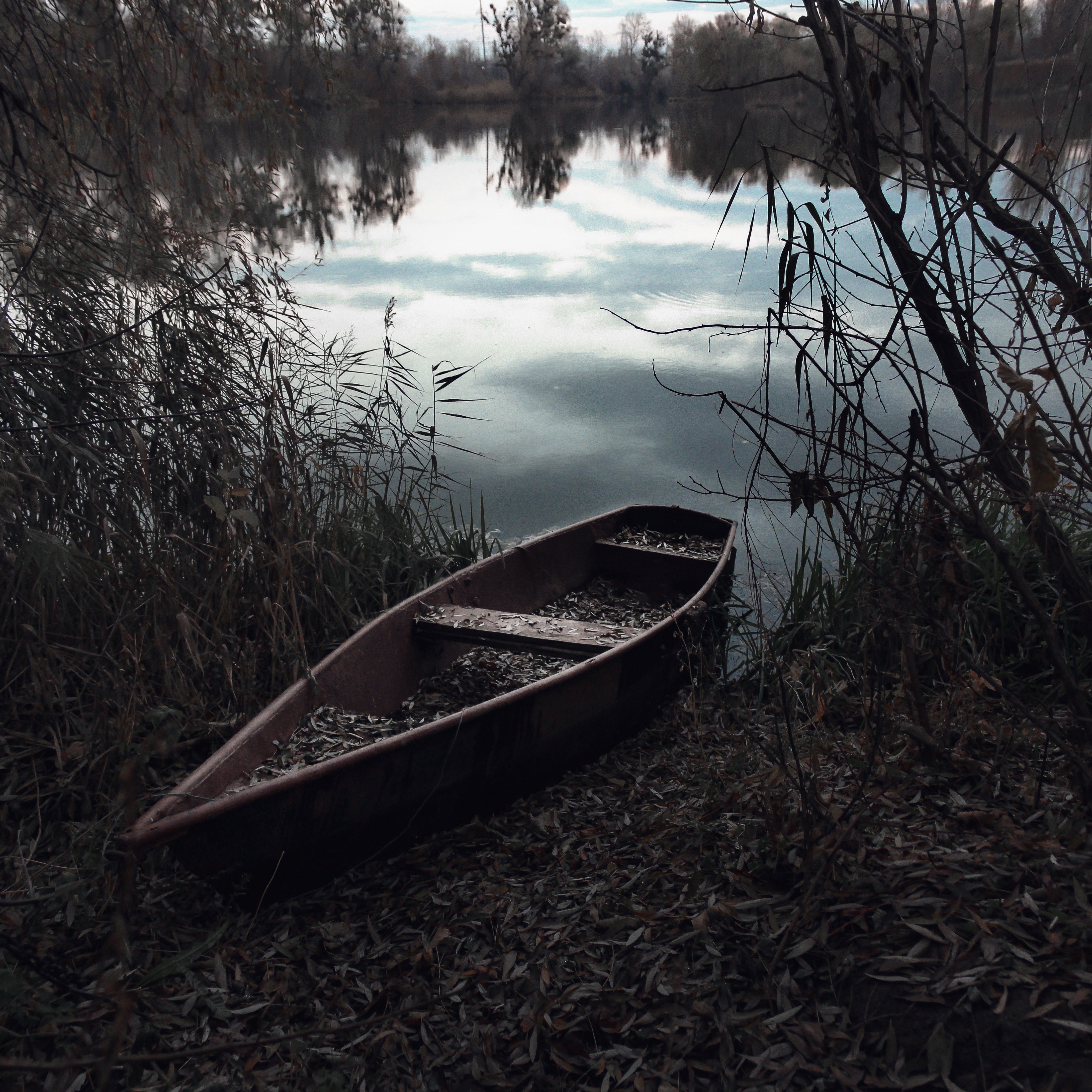 brown row boat on body of water painting  u00b7 free stock photo