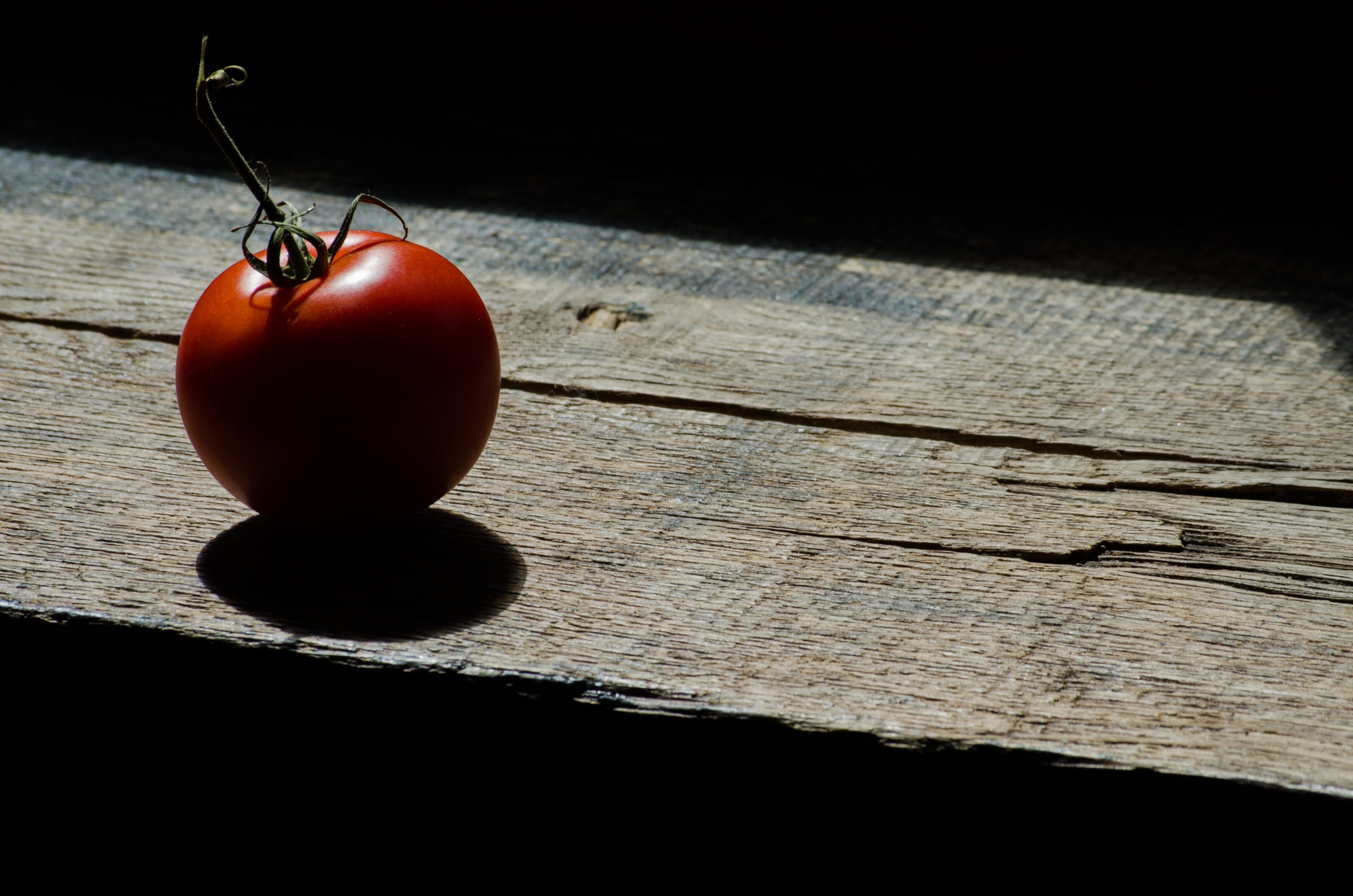 Red Tomato on Brown Surface