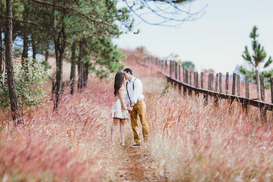 Couple Kissing Beside Trees