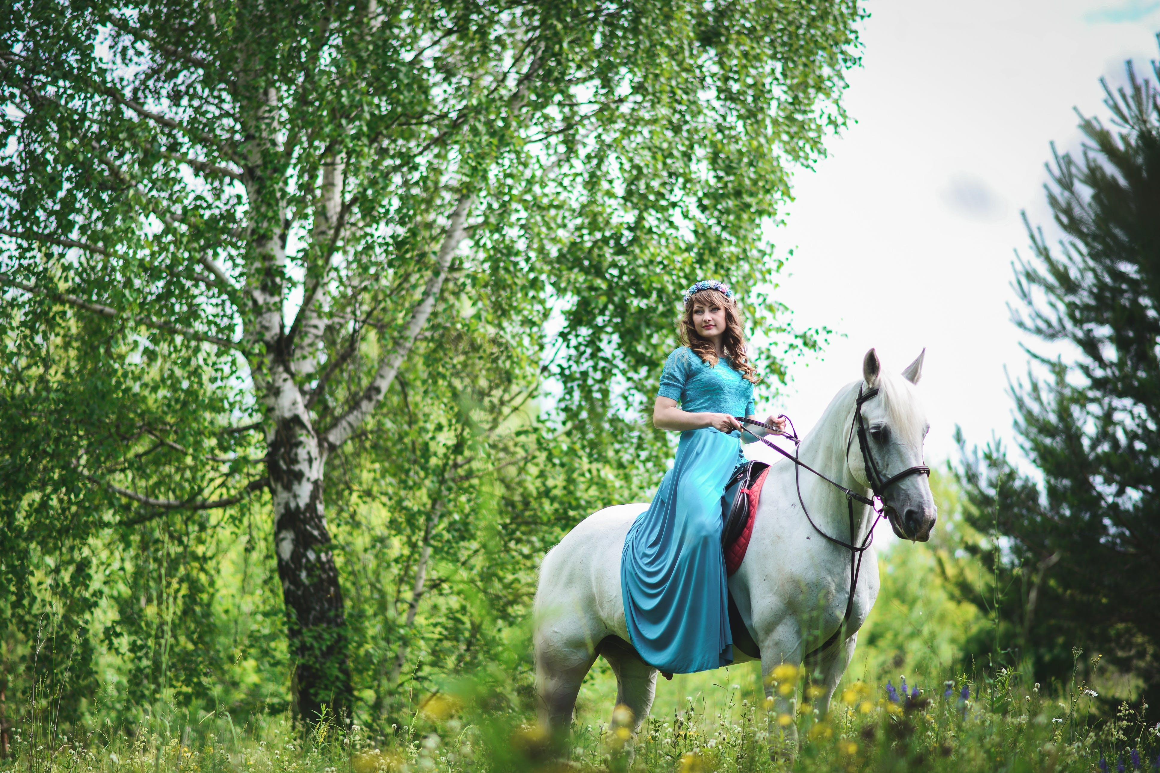Woman in White Horse Inside Forest