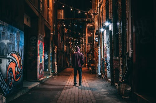 Man Standing on Brown Pathway