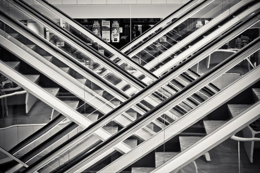 Grayscale Photography of Staircases With Handrails