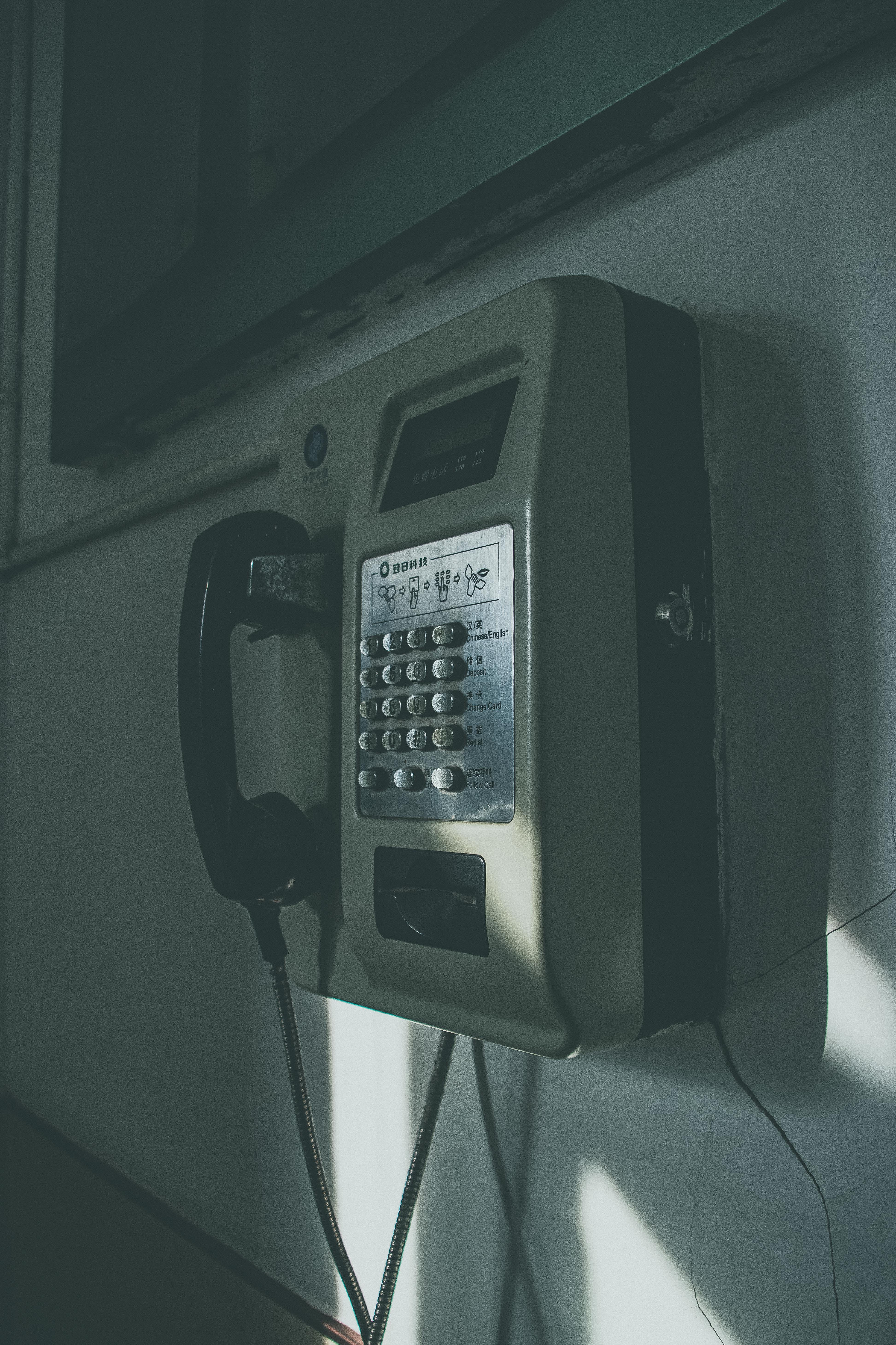 Gray and Black Public Phone