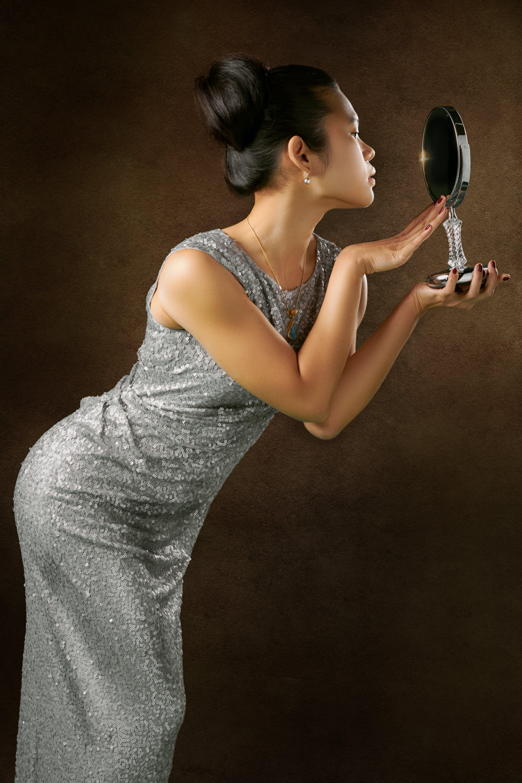 Photo of Woman Wearing Silver Dress