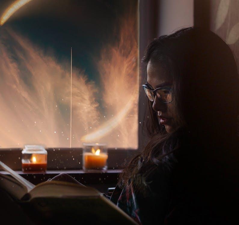 Woman Sitting While Wearing Black Framed Eyeglasses