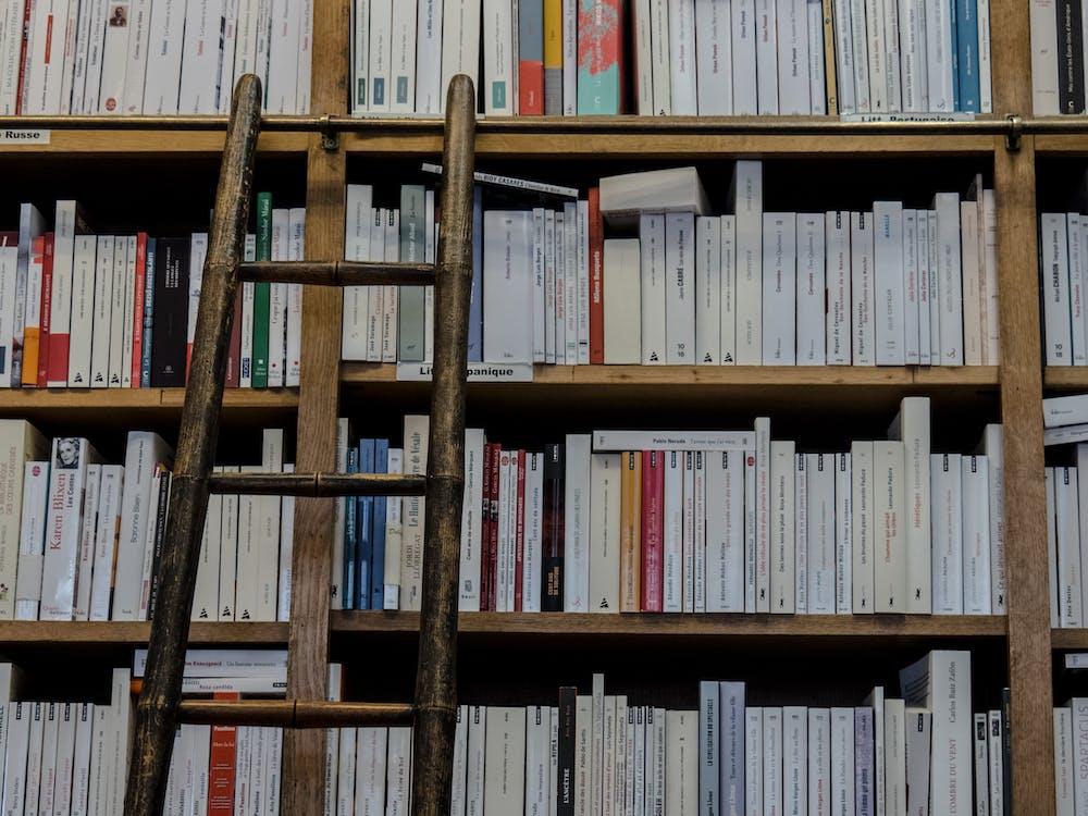 Brown Wooden Ladder on Brown Wooden Bookshelf