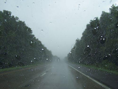 Free stock photo of Rain windshield, road