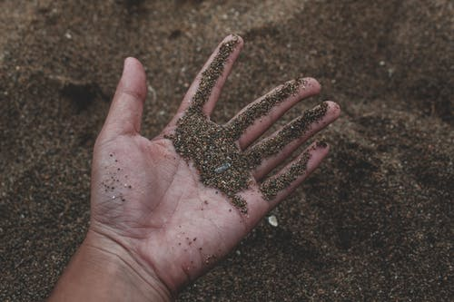 Close-Up Photo of Person Holding Sand