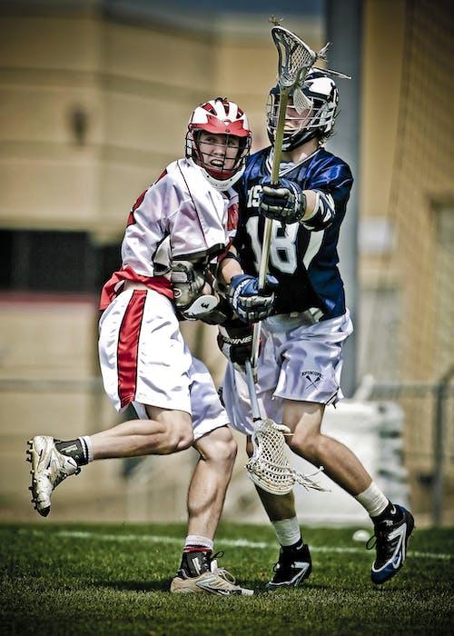 Two Men Playing Lacrosse