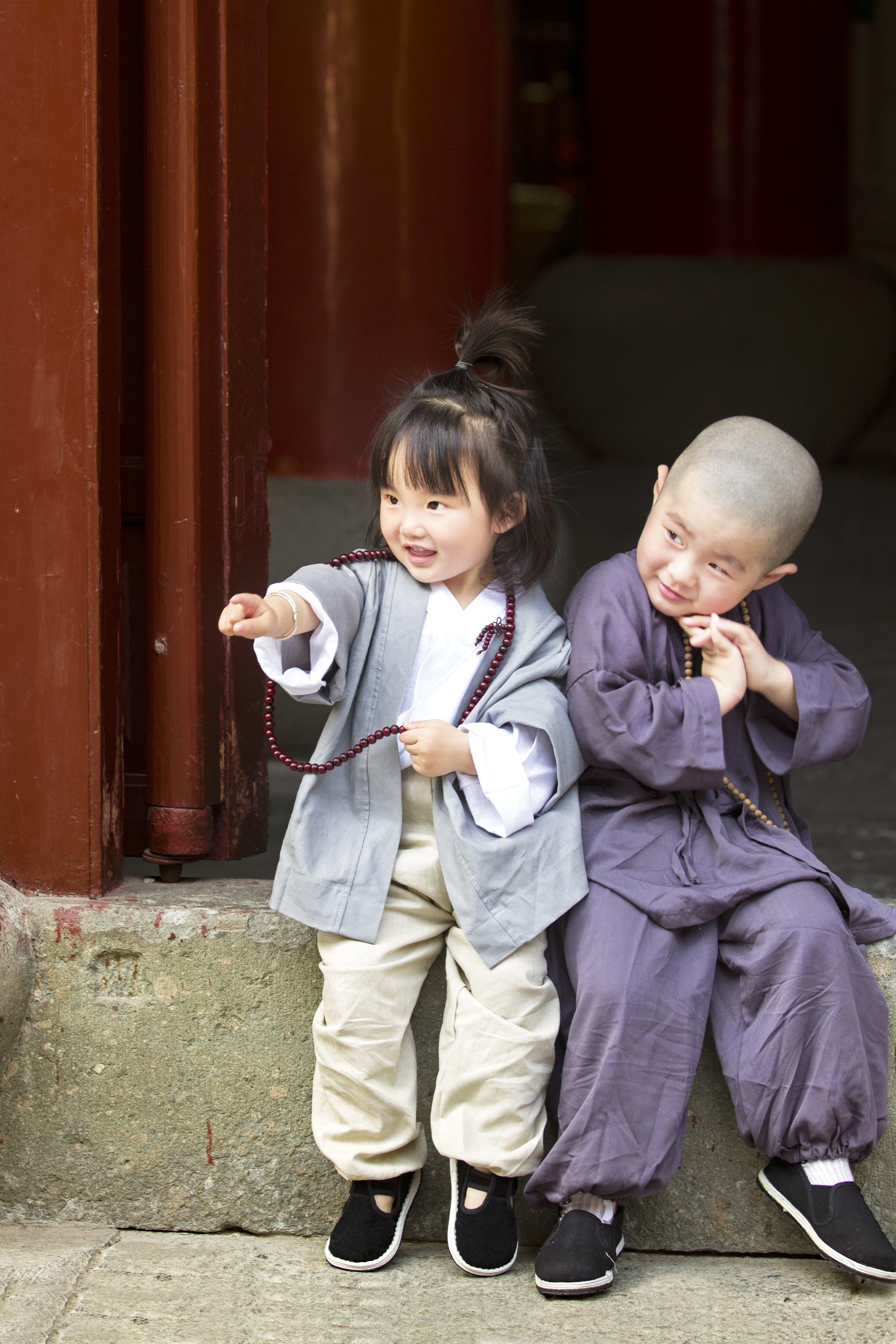 Boy and Girl Sitting on Doorway