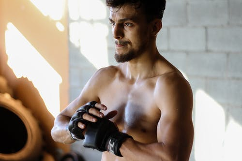 Topless Man With Black Ufc Fingerless Gloves