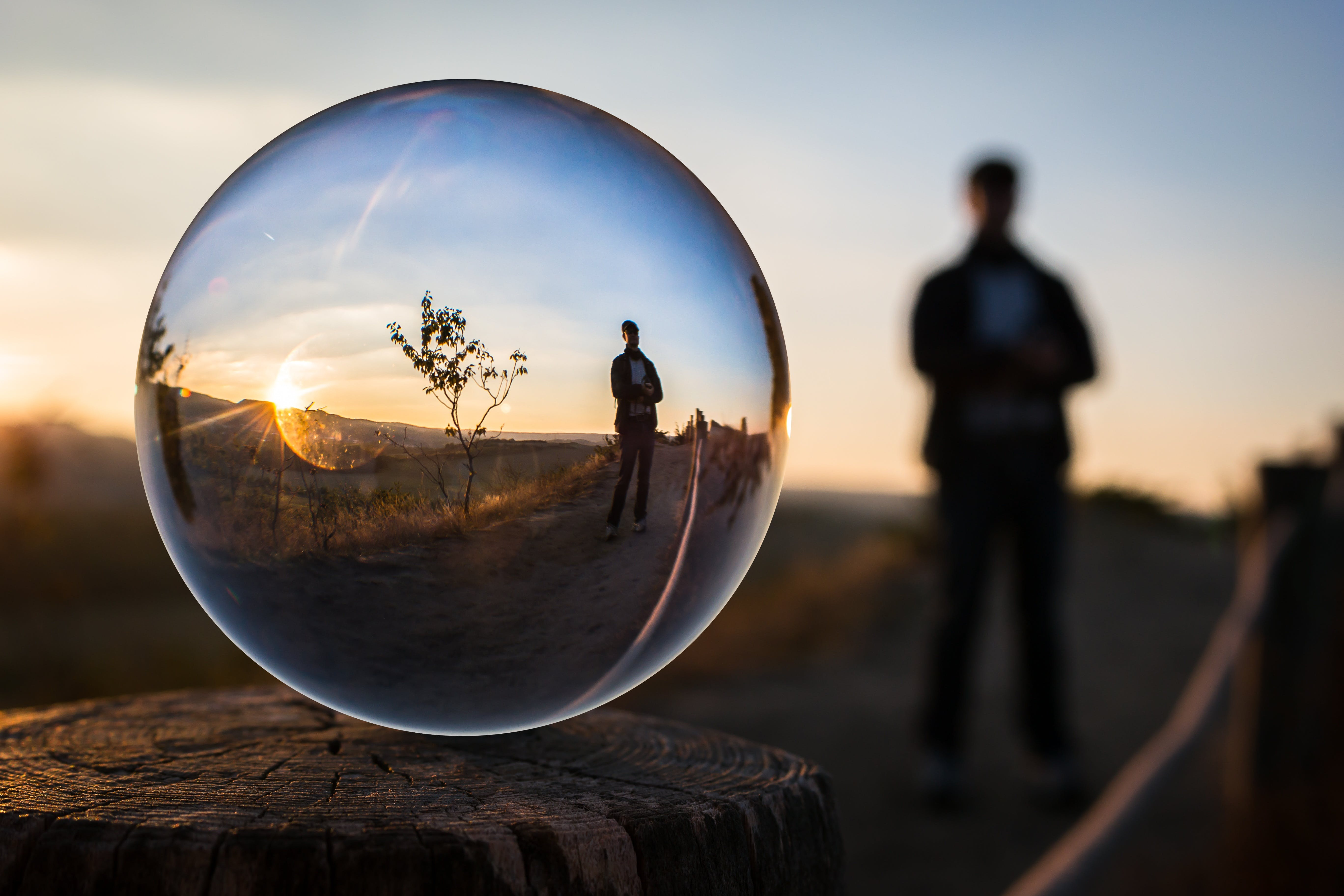 Forced Perspective Selective Focus Photography of Man Inside the Ball