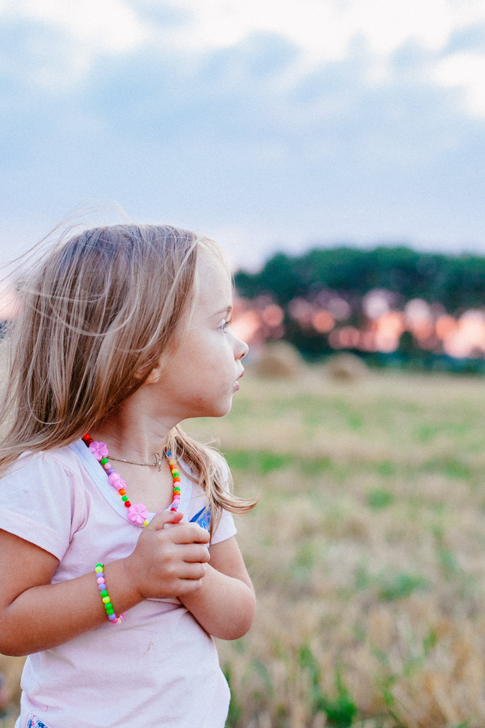 Selective Focus Photography of Girl on Grass Field