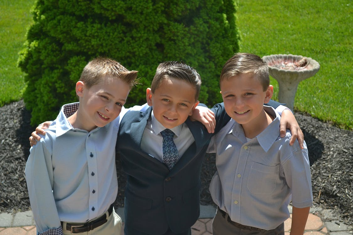 Three Boys Taking Selfie Outdoors