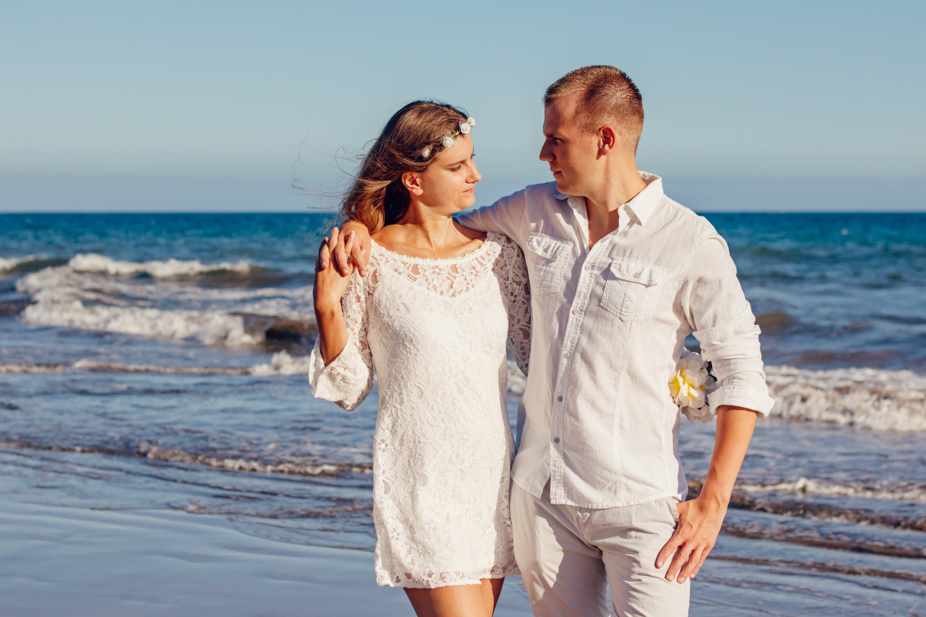 Couple Looking at Each Other Beside Beach
