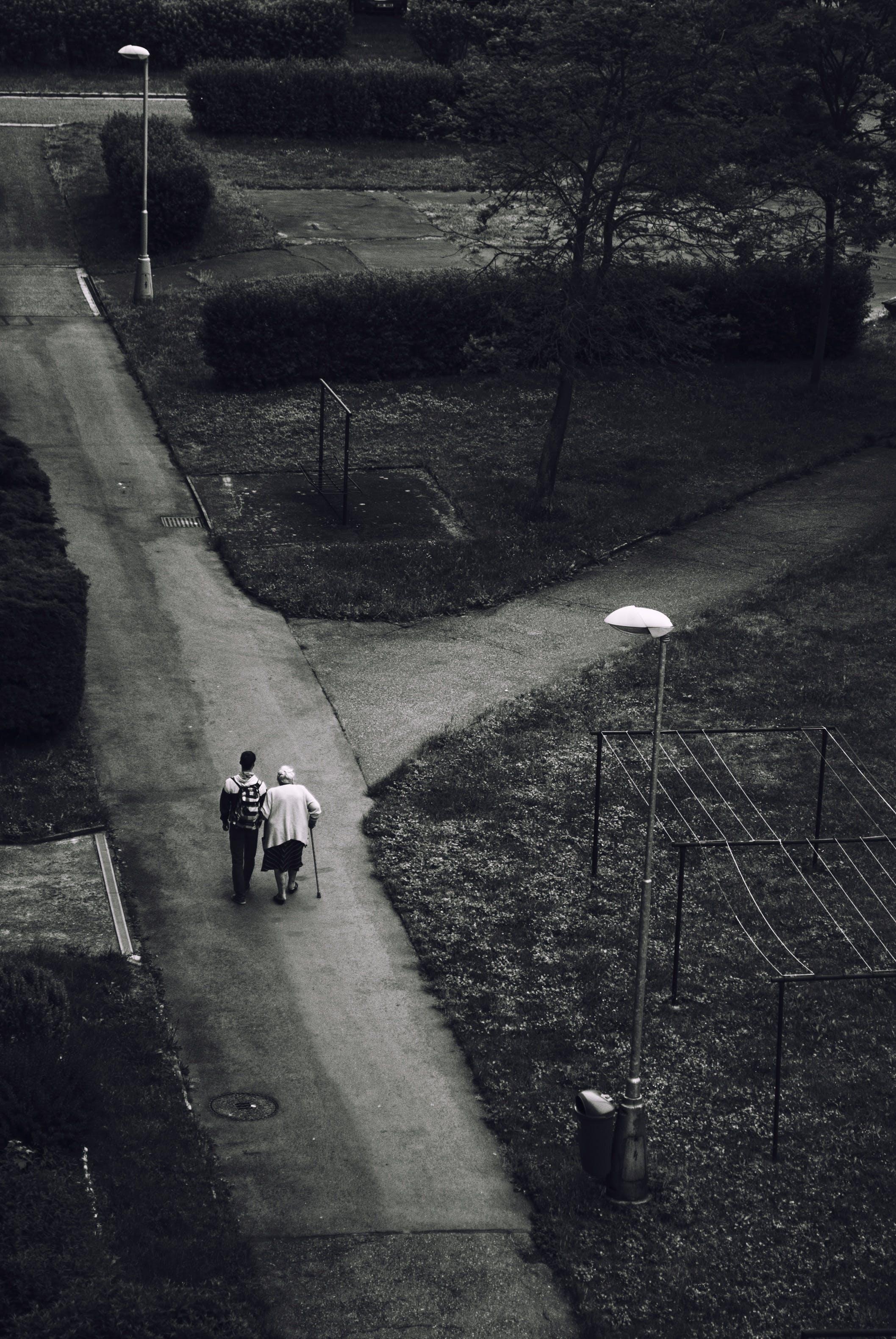 Man Walking Beside Woman on Road