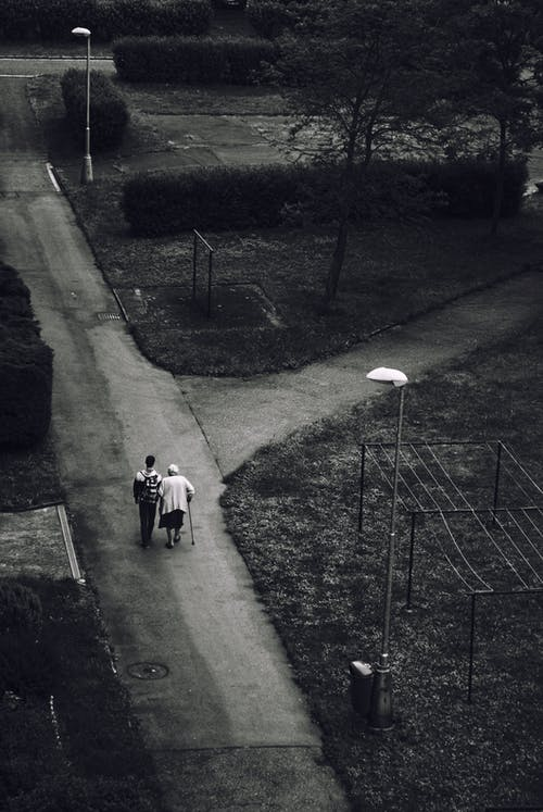 Man Walking Beside Woman on Road