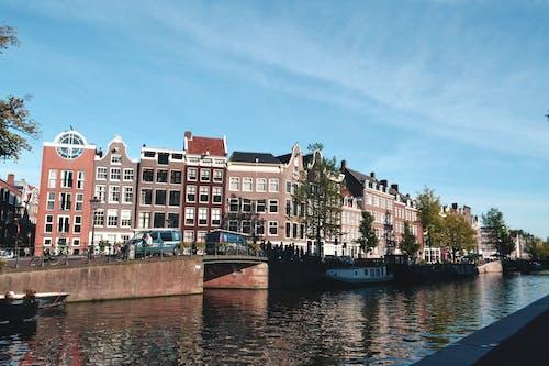 Gratis lagerfoto af #vand, Amsterdam, blå himmel, bygninger
