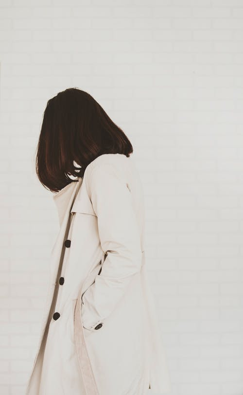 Woman in White Coat on a white background