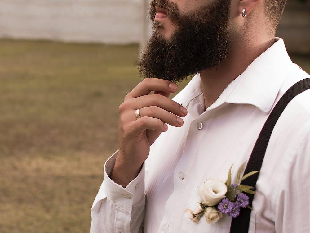 Man Holding His Beard