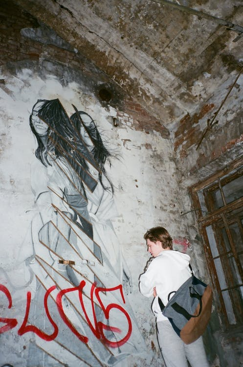 Woman in Fornt of Graffiti