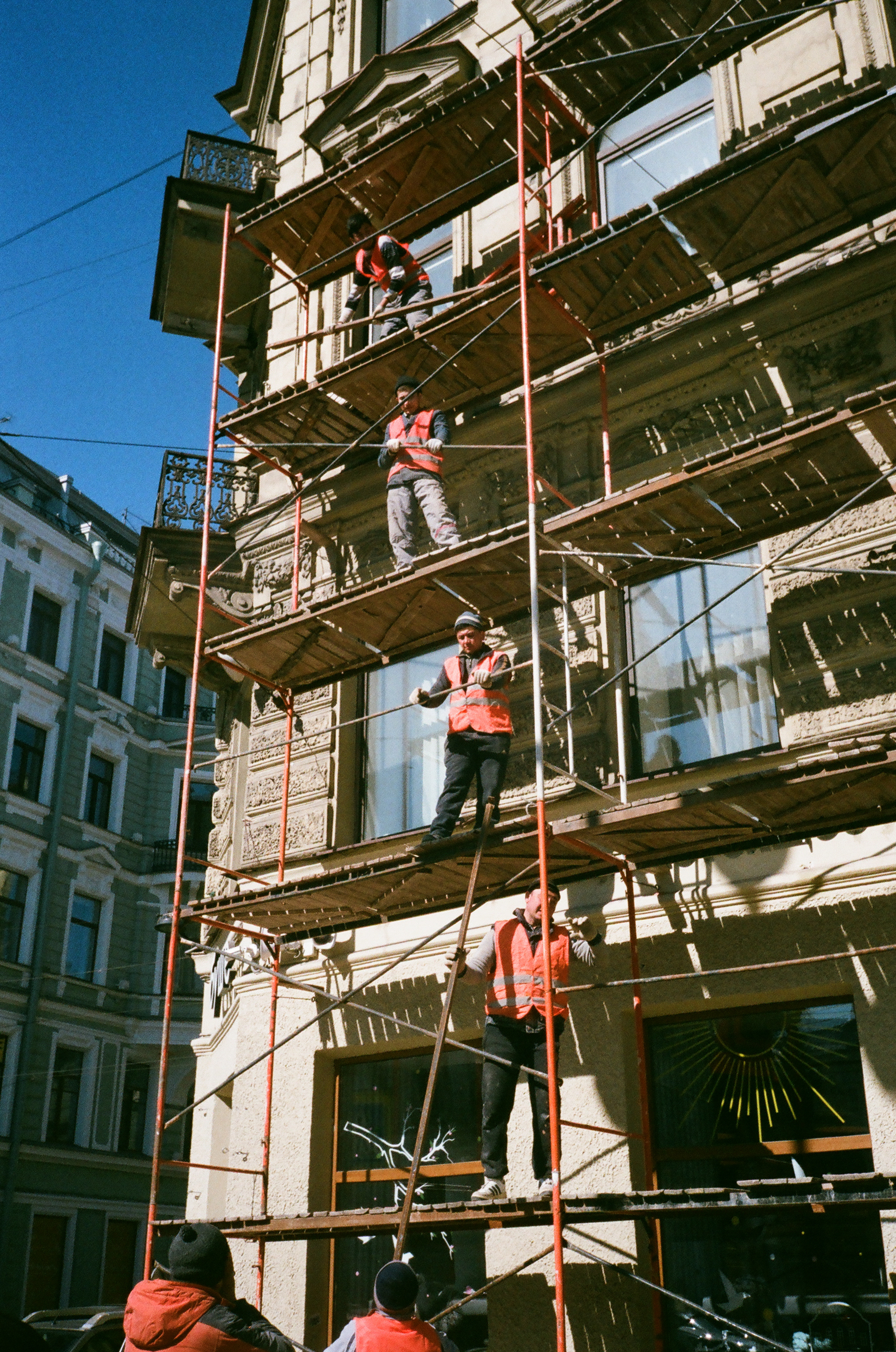 Men on Brown Scaffolding