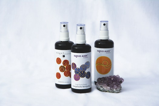 3 Spray Bottles Near Purple Geode