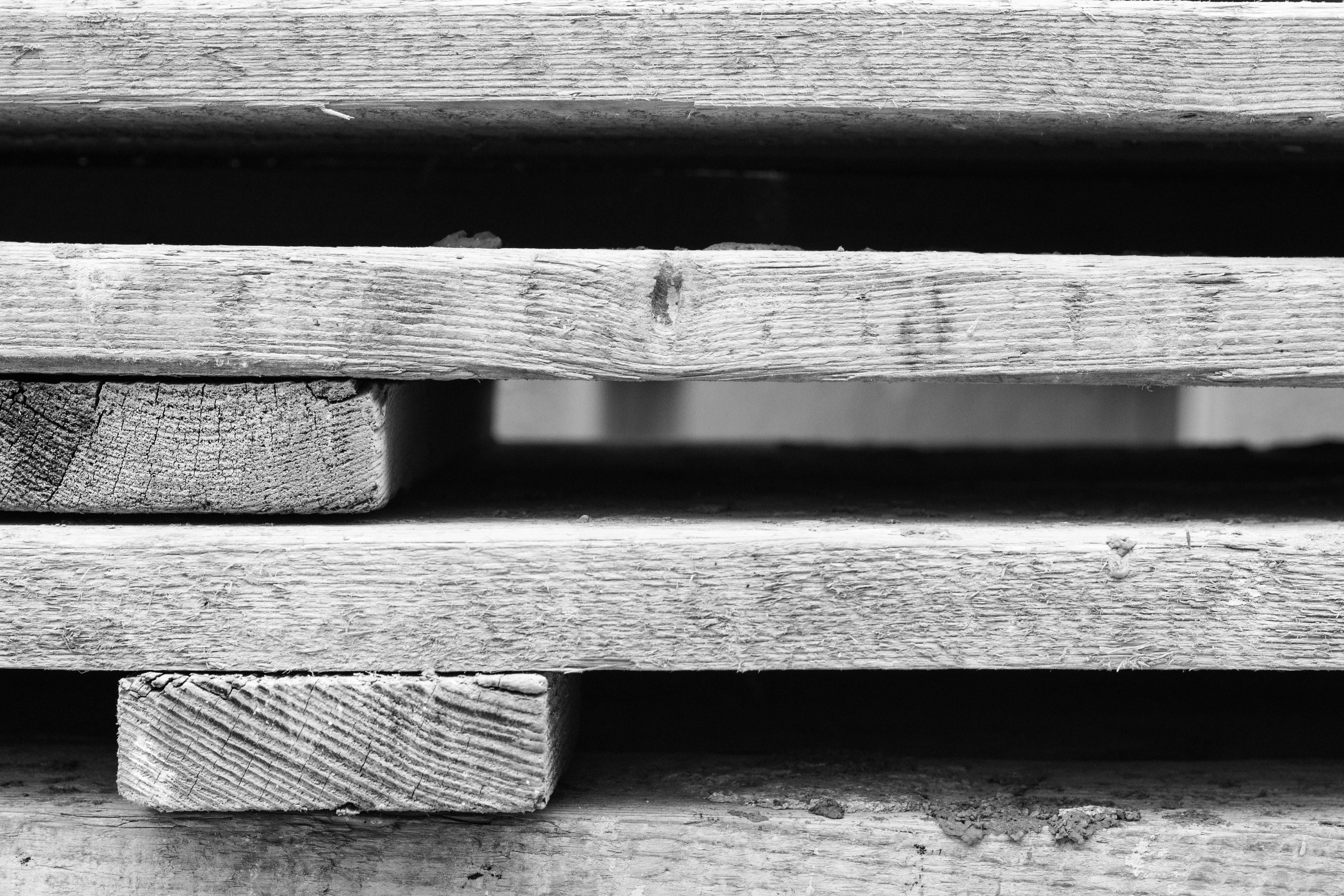 Grayscale Photo of Wooden Pallets