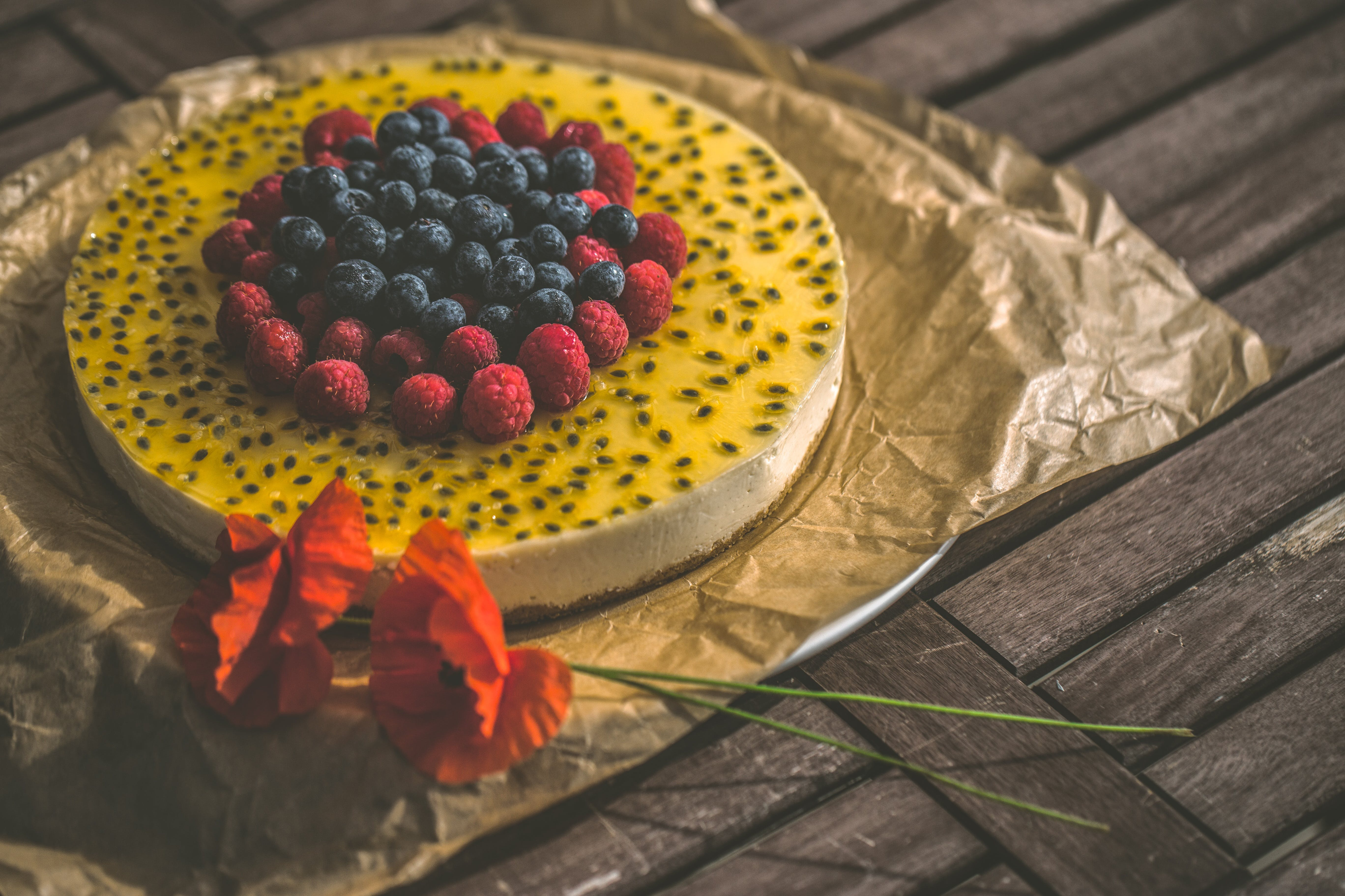 Red and Blueberry Cake on Brown Wooden Surface