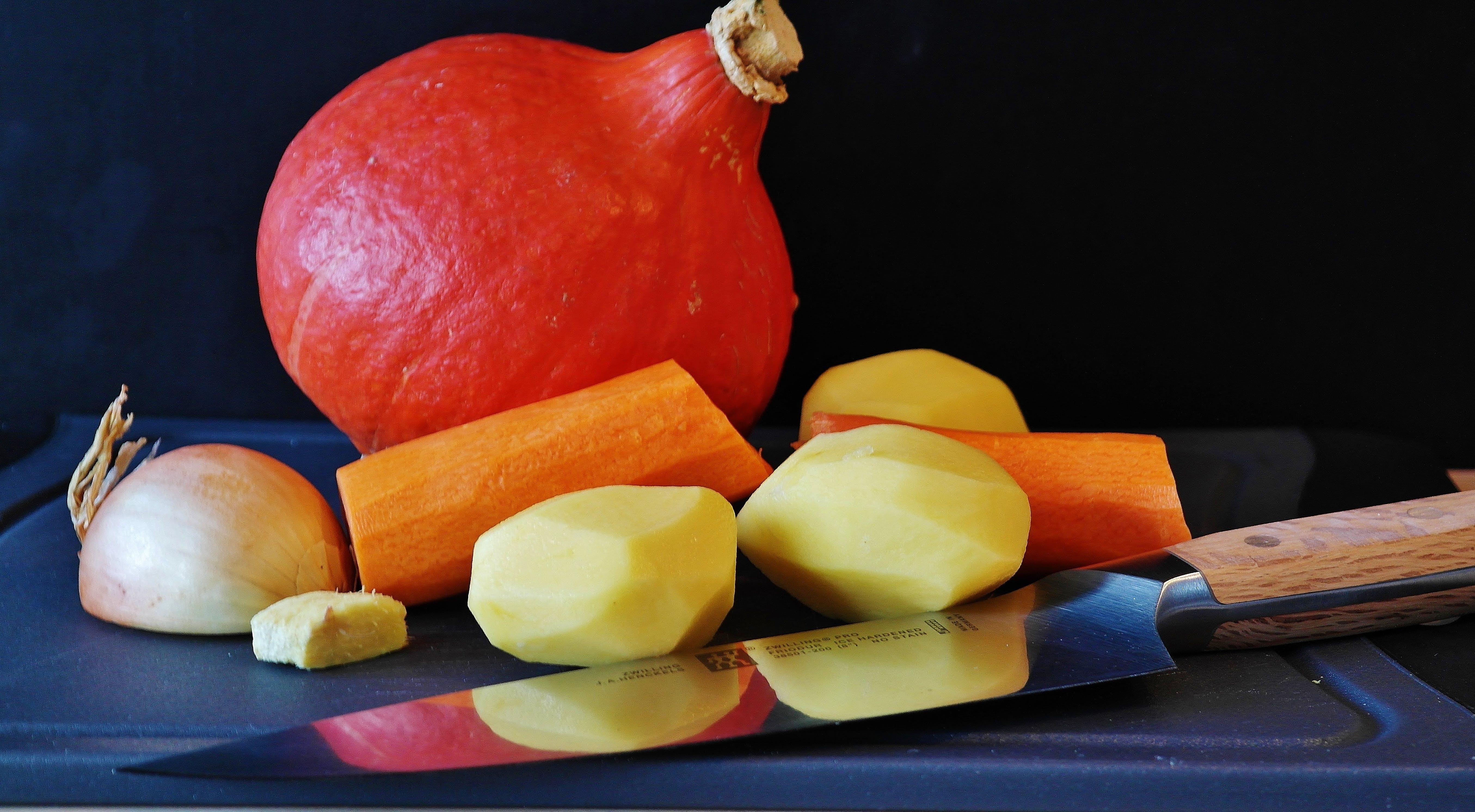 Kitchen Knife With Peeled Sweet Potato and Sliced Garkuc