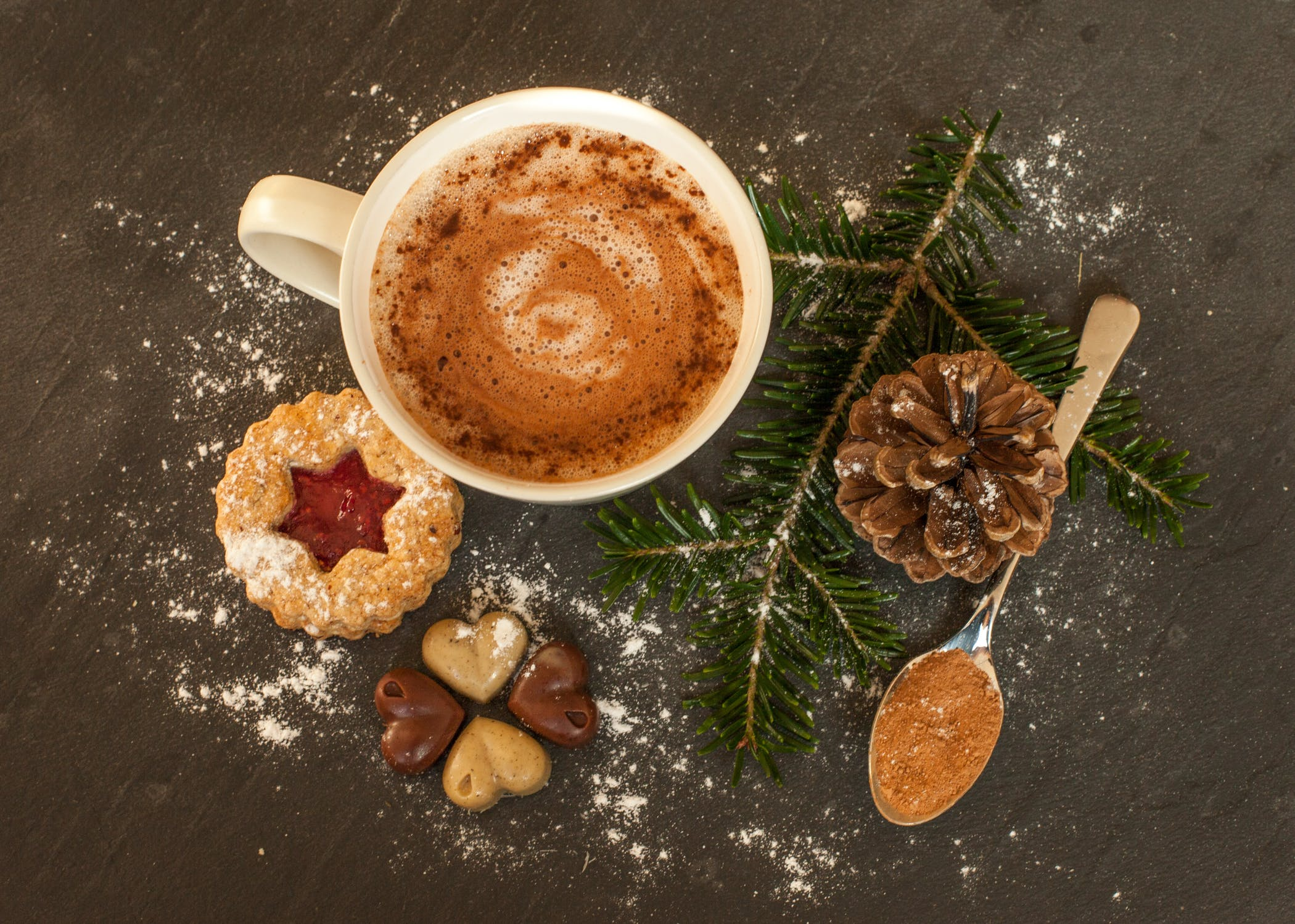 Coffee and Christmas cookies with greenery