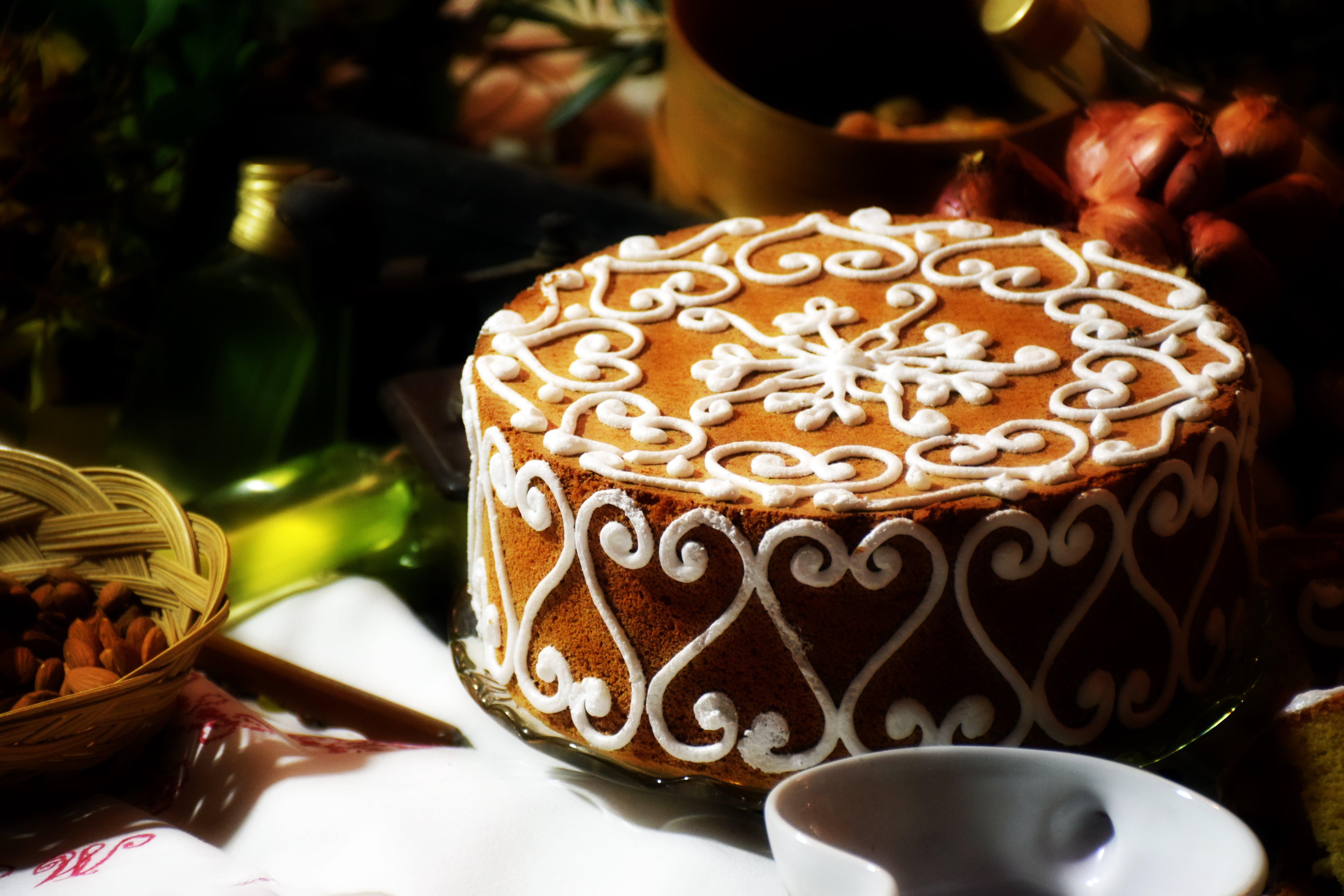 Brown Cake in Front of White Ceramic Bowl