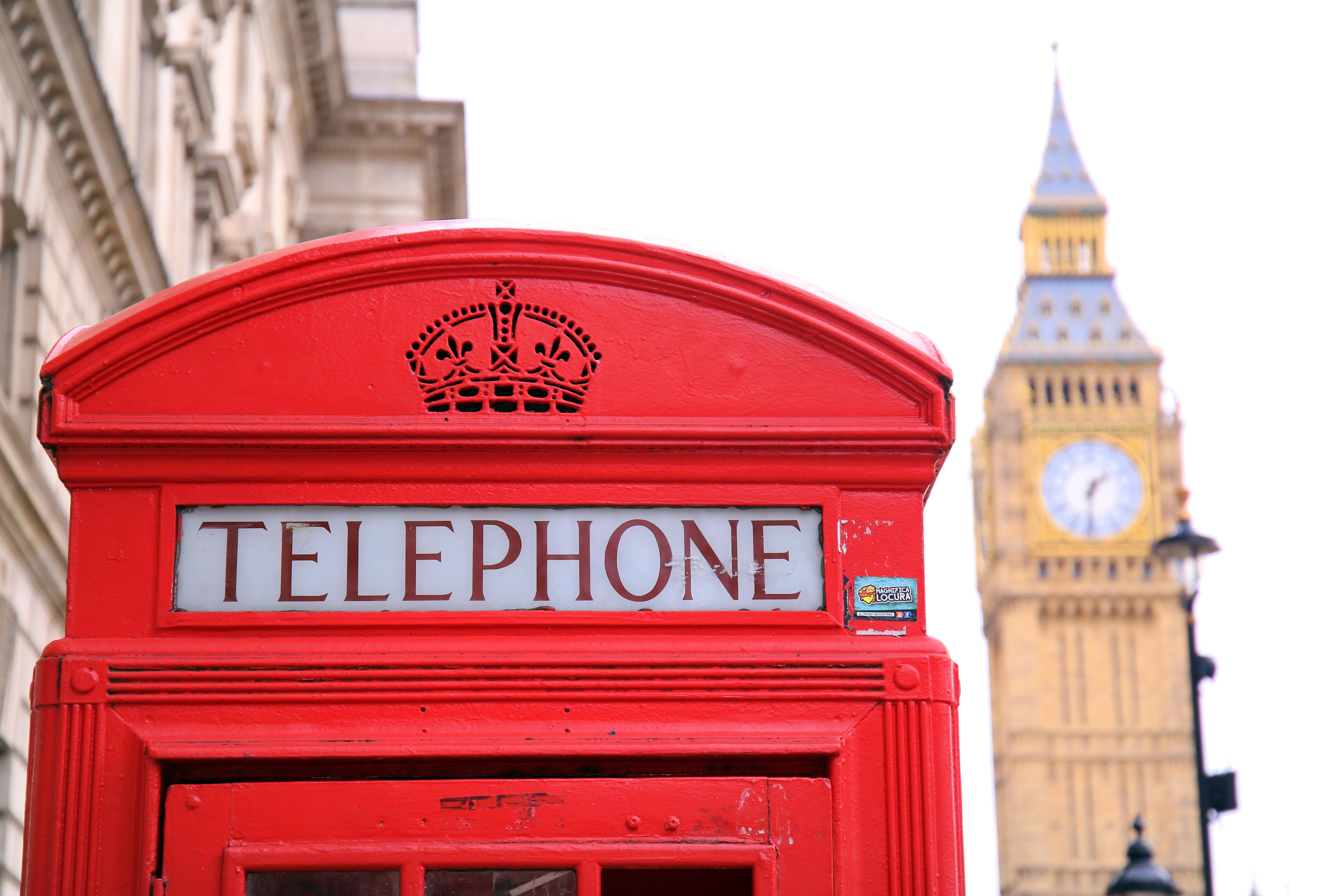 Red Telephone Booth in Front of Big Ben