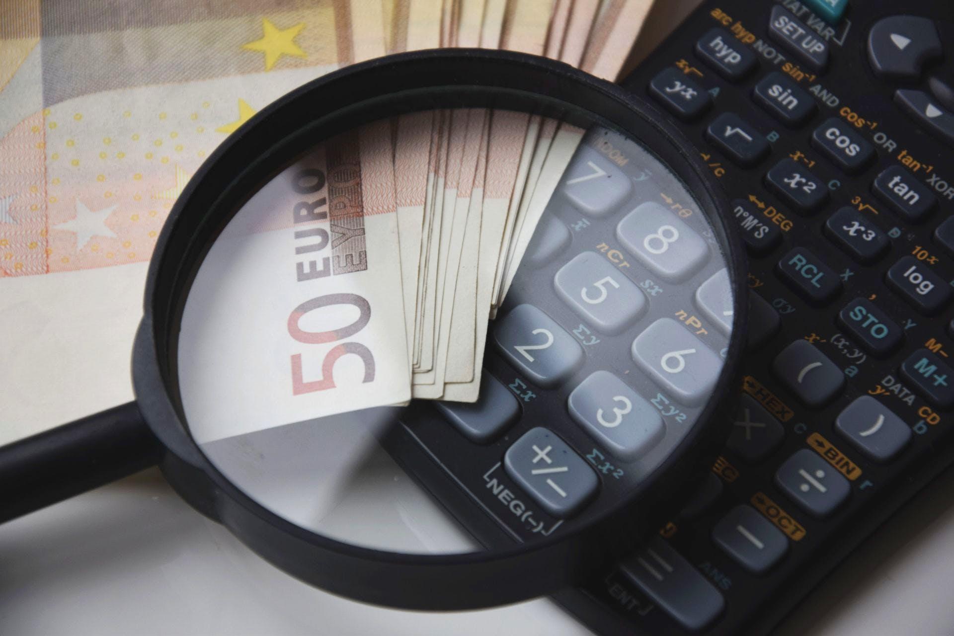 50 Euro Banknote Beside Black Calculator